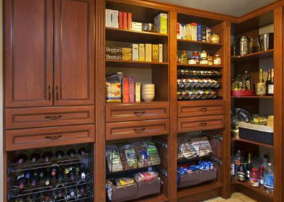 Pantry - Luxury Pantry Spice Racks Crown Moulding Wine Corner shelves Doors Cognac Premier