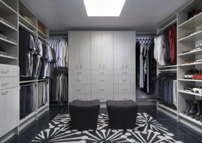 Walk In Closet - Concrete Flat Finish angled and straight shoe shelves